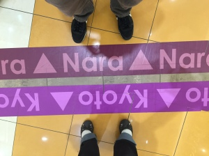 Sometimes, I do feel like we're standing on opposite sides of an issue, haha!  No, we actually were in a shopping mall and there marked the border between the two prefectures.